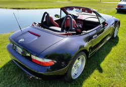1999 BMW M Roadster in Cosmos Black Metallic over Imola Red & Black Nappa