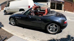2000 BMW M Roadster in Cosmos Black Metallic over Kyalami Orange & Black Nappa